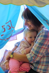 Practitioner and child in a tent