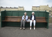 small image of two people sitting on a bench