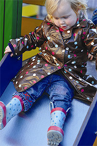 Young girl going down slide at Brightstart Nursery