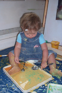 Child doing messy play