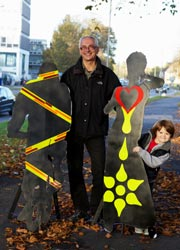 Cllr Davey with road safety silhouettes