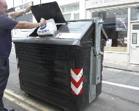 small image of someone using the communal street bins
