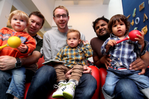 Dad's enjoying taking part with their kids at a baby boogie session in Jubilee library