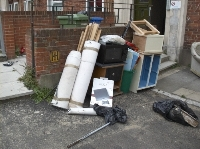 small image of some dumped items on the pavement