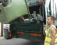 small image of refuse being collected