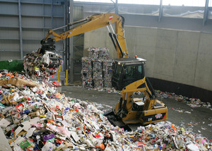 a vehicle picking up mixed recycling
