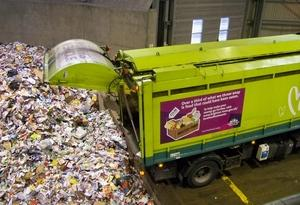 The recycling truck tipping recycling in the facility