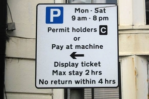 pay and display or permit holders sign