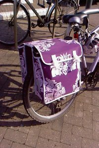Purple pannier on the back of a bike