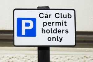 A car club sign showing restrictions
