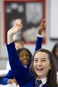 Schoolgirl with her hand up