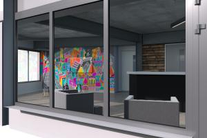 Reception area of Kings College Brighton showing a colourful mural