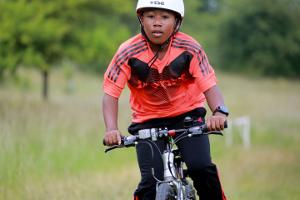 Young boy riding a bike at Bikestock 2015