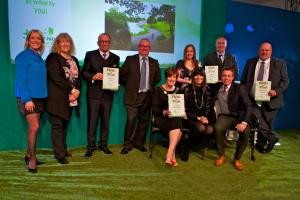 Andy Jeavons, site's garden manager (far right) and Tony Elkins, a volunteer (4th from left) collecting award