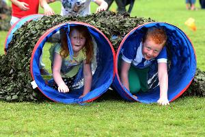 Children enjoying an assault course