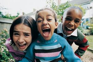 Three children laugh