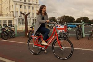 Lady riding a Bikeshare bicycle