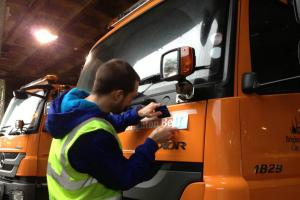 Cityclean staff printing name onto gritter