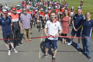 Pete Mitchell opening the track with cyclists behind him