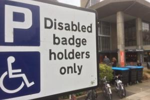 a disabled parking bay sign outside Hove Town Hall