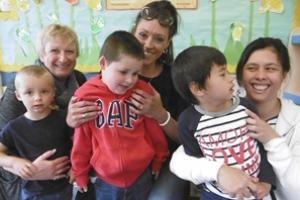 Sue White (left) is pictured with Ronnie, parent Rachel Childs (centre) with Samuel; and parent Cheryl Malabanan with Aaron