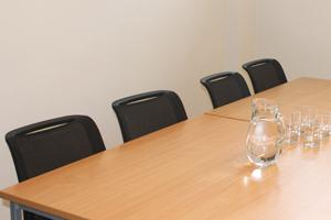 jubilee library conference room four, a table and chairs with water and glasses on the table
