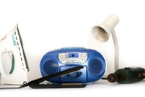 Small picture of some small electrical items including an iron and a lamp