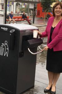 Cllr Mitchell with a bigbelly bin