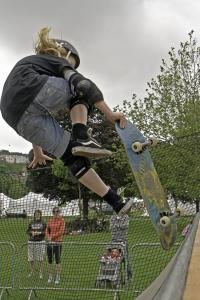 Young person riding a half pipe
