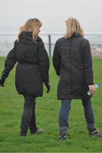 women walking towards the sea