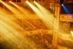 Theatre Royal lights beaming down on audience and stage