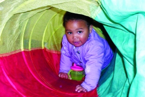 Young child crawling through tunnel