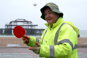 Beach cleaner spending his break playing ping pong