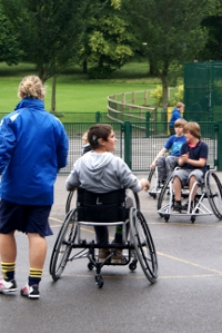 Young people play wheelchair football